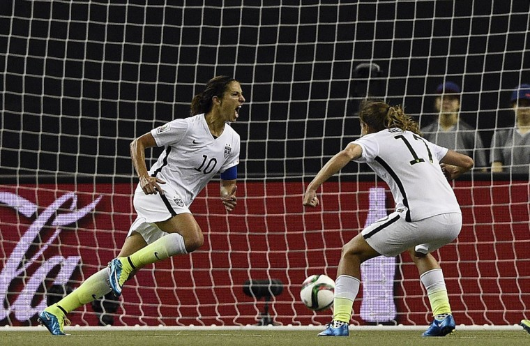 USA midfielder Carli Lloyd (L) celebrates her goal during the semi-final football match between USA and Germany during their 2015 FIFA Women's World Cup at the Olympic Stadium in Montreal on June 30, 2015. (Franck Fife/AFP/Getty Images)