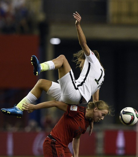 USA midfielder Tobin Heath (TOP) vies with Germany's goalkeeper Almuth Schult during the semi-final football match between USA and Germany during their 2015 FIFA Women's World Cup at the Olympic Stadium in Montreal on June 30, 2015. (Franck Fife/AFP/Getty Images)