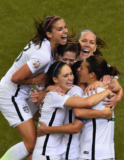USA's midfielder and goal scorer Carli Lloyd (R) celebrates with teammates during their 2015 FIFA Women's World Cup semifinal match against Germany at Olympic Stadium in Montreal on June 30, 2015. (Nicholas Kamm/AFP/Getty Images)