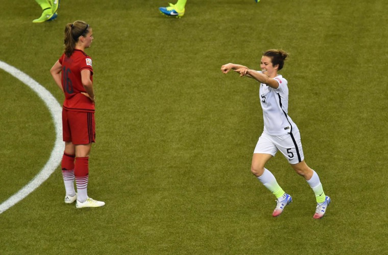 USA's defender Kelley O'Hara (R) celebrates her goal against Germany during their 2015 FIFA Women's World Cup semifinal match at Olympic Stadium in Montreal on June 30, 2015. The USA won 2-0. (Nicholas Kamm/AFP/Getty Images)