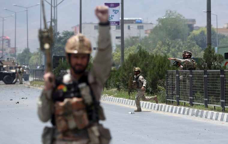 Afghan security forces run at the site of a suicide attack during clashes with Taliban fighters in front of the Parliament, in Kabul, Afghanistan, Monday, June 22, 2015. The Taliban launched a complex attack on the Afghan parliament Monday, with a suicide car bomber striking at the entrance and gunmen battling police as lawmakers were meeting inside to confirm the appointment of a defense minister, police and witnesses said. (AP Photo/Massoud Hossaini)