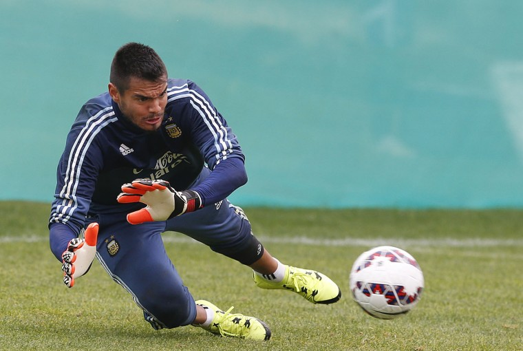 Argentina's goalkeeper Sergio Romero practices during a training session in La Serena, Chile, Monday, June 22, 2015. Argentina will face Colombia in the next round of the Copa America soccer tournament on Friday. (AP Photo/Andre Penner)
