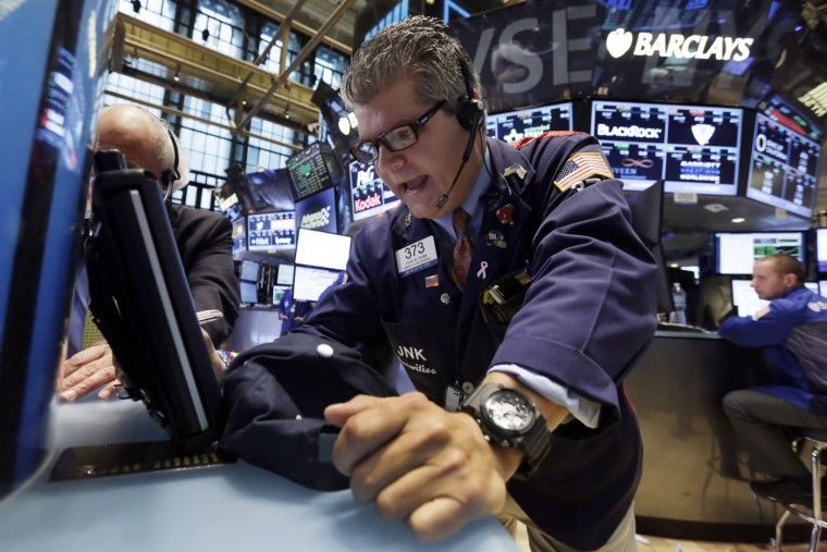 Trader John Panin works on the floor of the New York Stock Exchange, Monday, June 22, 2015. U.S. stocks advanced Monday on hopes of a breakthrough in talks between Greece and its lenders. (AP Photo/Richard Drew)
