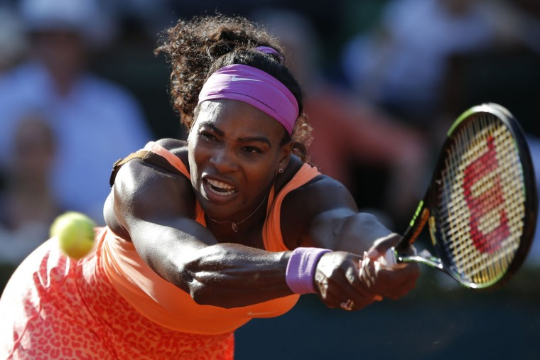 Serena Williams of the U.S. returns in her semifinal match of the French Open tennis tournament against Timea Bacsinszky of Switzerland at the Roland Garros stadium, in Paris, France, Thursday, June 4, 2015. Williams won in three sets 4-6, 6-3, 6-0. (AP Photo/Francois Mori)