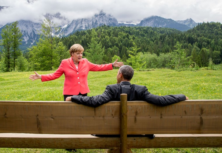 German Chancellor Angela Merkel speaks with U.S. President Barack Obama at Schloss Elmau hotel near Garmisch-Partenkirchen, Germany, Monday, June 8, 2015, during the G-7 summit. (Michael Kappeler/Pool Photo via AP)