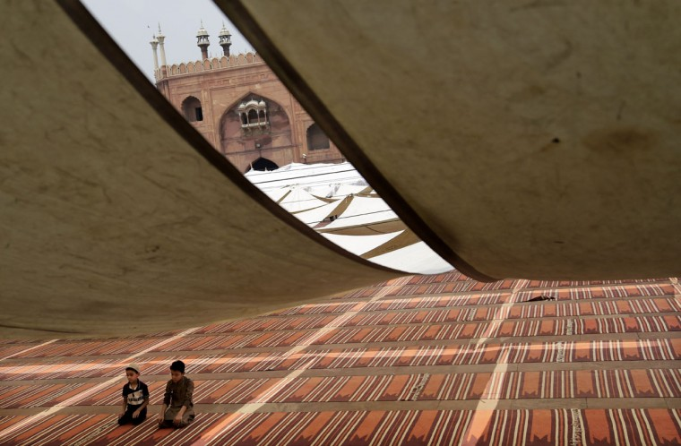 Indian Muslim boys pray in the compound of Jama Masjid on the first day of the holy month of Ramadan in New Delhi, India, Friday, June 19, 2015. Muslims throughout the world are marking the month of Ramadan, the holiest month in the Islamic calendar during which devotees fast from dawn till dusk. (AP Photo/Altaf Qadri)