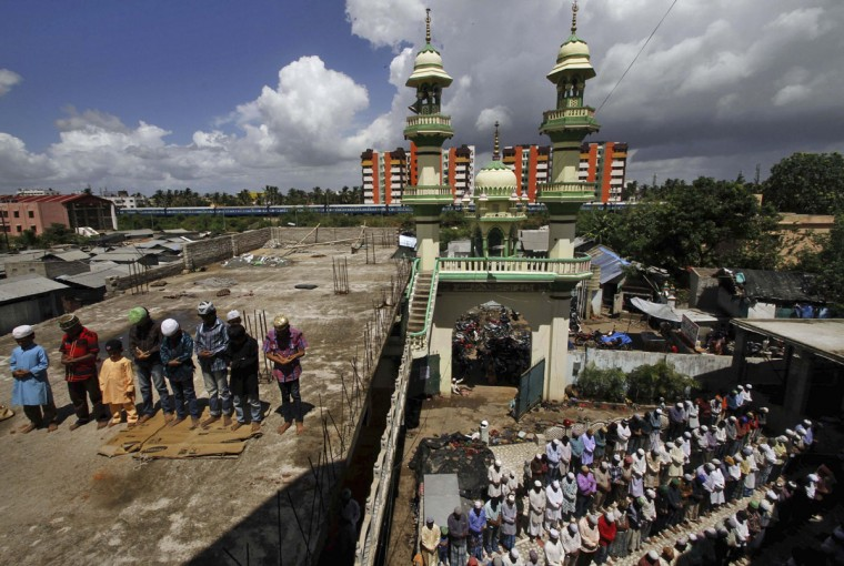 Muslims offer Friday prayers at a mosque on the first day of the holy month of Ramadan in the eastern Indian city of Bhubaneswar, India, Friday, June 19, 2015. Muslims throughout the world are marking the month of Ramadan, the holiest month in the Islamic calendar during which devotees fast from dawn till dusk. (AP Photo/Biswaranjan Rout)