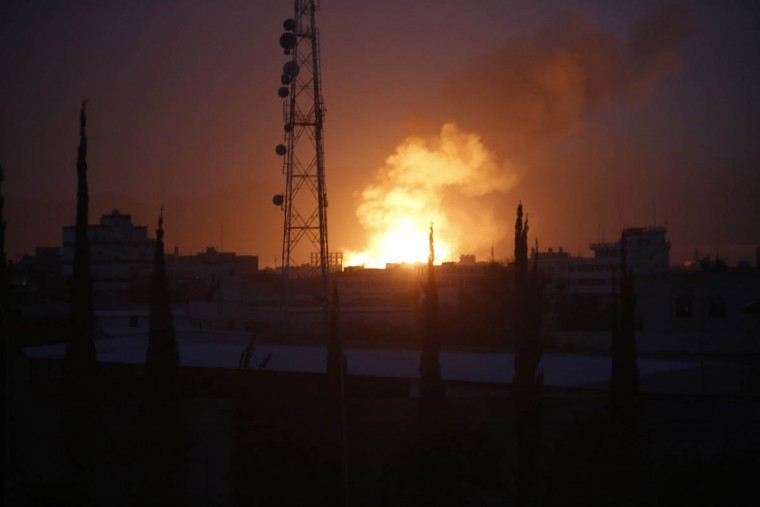Fire and smoke rises after a Saudi-led airstrike hit a site believed to be one of the largest weapons depot on the outskirts of Yemen's capital, Sanaa. The airstrikes and ground fighting have killed more than 1,000 civilians and displaced a half million people, according to the U.N. (Hani Mohammed/AP photo)