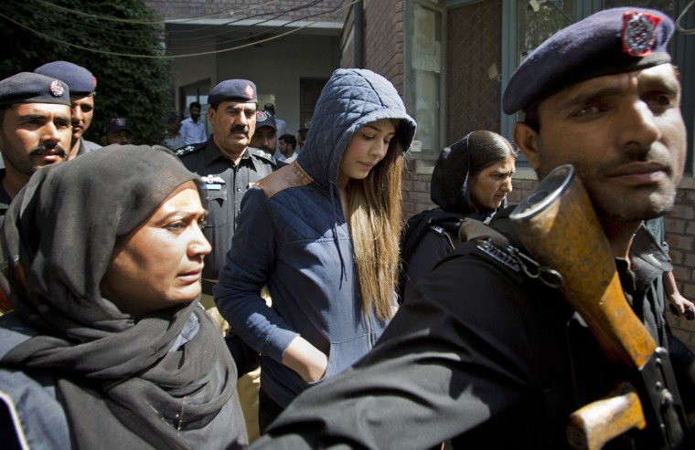 Pakistan's top model, Ayaan Ali, center, arrives in tight security to appear in a court in Rawalpindi, Pakistan, Monday, June 1, 2015. Ali is under detention since her midnight arrest on March 14 at Islamabad airport and faces money laundering charges after authorities seized over $500,000 before she boarded a Dubai-bound flight. Pakistani law makes it illegal†for a passenger†carry over $10,000 on†a flight. (AP Photo/B.K. Bangash)