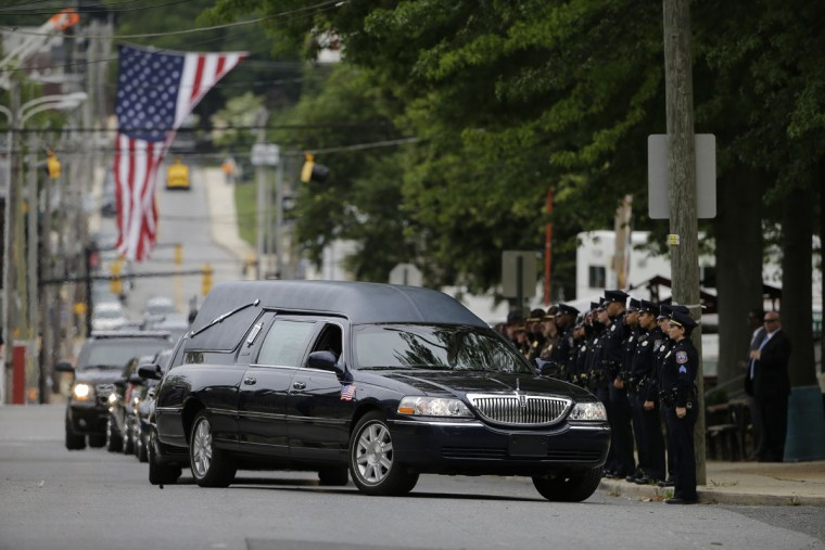 The funeral procession for former Delaware Attorney General Beau Biden arrives at St. Anthony of Padua Roman Catholic Church in Wilmington, Del., Saturday, June 6, 2015. Biden, the eldest son of the vice president, died of brain cancer May 30 at age 46. (AP Photo/Matt Rourke)