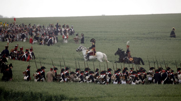 In this June 20, 2010, file photo, re-enactors march through a field during a living history event of the 1815 Battle of Waterloo in Waterloo, Belgium. More than 5,000 Napoleonic era re-enactors will participate in the upcoming 200th anniversary of the Battle of Waterloo which takes place in June 2015. (AP Photo/Virginia Mayo, File)