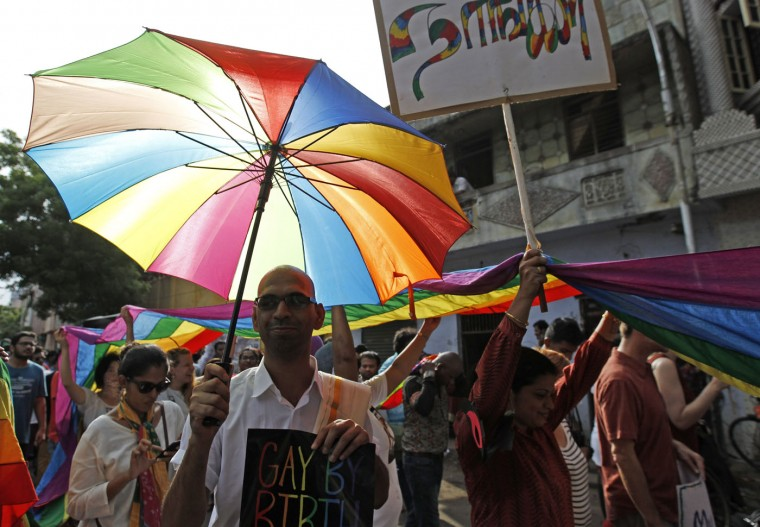 "Activists of the Lesbian, Gay, Bisexual and Transgender (LGBT) rights and their supporters participate in a Rainbow Pride Rally in Chennai, India, Sunday, June 28, 2015. The participants hailed Friday's U.S. Supreme Court ruling, giving same-sex couples the right to marry in all 50 states. Placard on right in Tamil reads ""we"". (AP Photo/Arun Sankar K)"