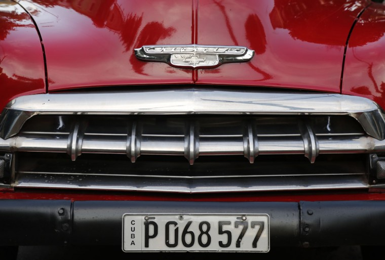 FILE - This Dec. 21, 2014 file photo shows the grill of a recently painted 1952 Chevrolet parked in Havana, Cuba. U.S. car sales have been banned in Cuba since 1959, forcing Cubans to patch together Fords, Chevrolets and Chryslers that date back to before Fidel Castro's revolution. (AP Photo/Desmond Boylan, File)