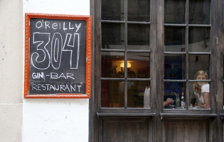 """Tourists eat at the paladar O'Reilly 304 in Old Havana, Cuba, Monday, June 1, 2015. When eating in Havana, stick to """"paladares"""" - privately owned restaurants. You'll need reservations for the best. Prices are moderate but not cheap. (AP Photo/Desmond Boylan) Tourists eat at the paladar O'Reilly 304 in Old Havana, Cuba, Monday, June 1, 2015. When eating in Havana, stick to """"paladares"""" - privately owned restaurants. You'll need reservations for the best. Prices are moderate but not cheap. (AP Photo/Desmond Boylan)"""