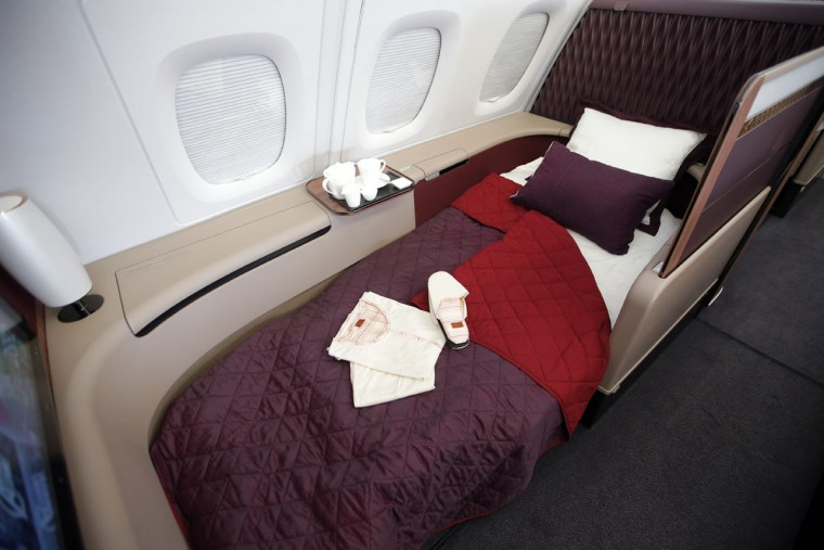 Interior view of the fully lie-flat seat converted into a bed in Premiere (1st) Class in the Airbus A380 of Qatar Airways presented at the Paris Air Show, in Le Bourget airport, north of Paris, Wednesday, June 17, 2015. Qatar Airways has brought 4 Airbus A380's in service since last year. (AP Photo/Francois Mori)