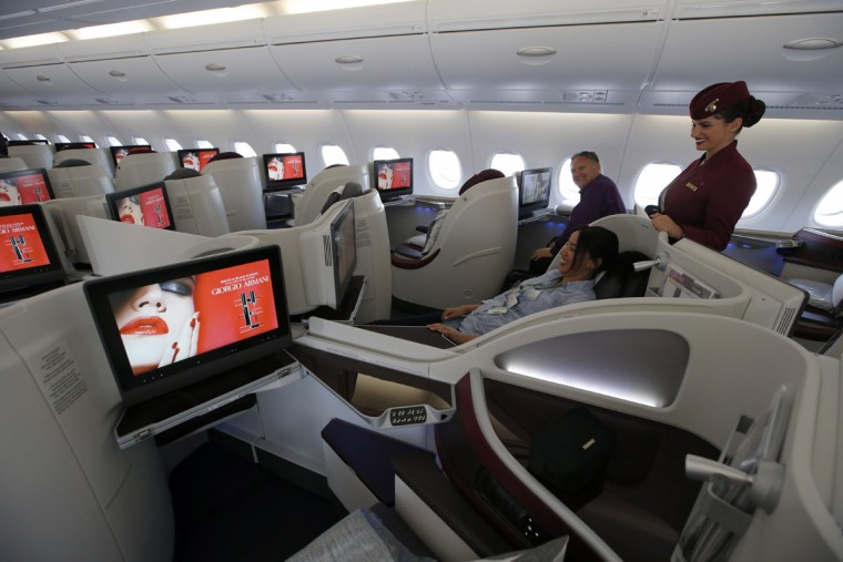 Interior view of the Business Class seats on the second floor deck of the Airbus A380 of Qatar Airways presented at the Paris Air Show, in Le Bourget airport, north of Paris, Wednesday, June 17, 2015. Qatar Airways has brought 4 Airbus A380's in service since last year. (AP Photo/Francois Mori)