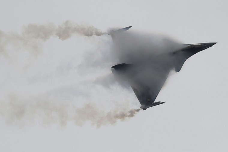 "French Capt. Benoit Planche, nicknamed ""Tao"", performs with a Rafale single seat jet aircraft during a demonstration flight at the Paris Air Show, in Le Bourget airport, north of Paris, Thursday, June 18, 2015. Some 300,000 aviation professionals and spectators are expected at this weekís Paris Air Show, coming from around the world to make business deals and see dramatic displays of aeronautic prowess and the latest air and space technology. (AP Photo/Francois Mori)"