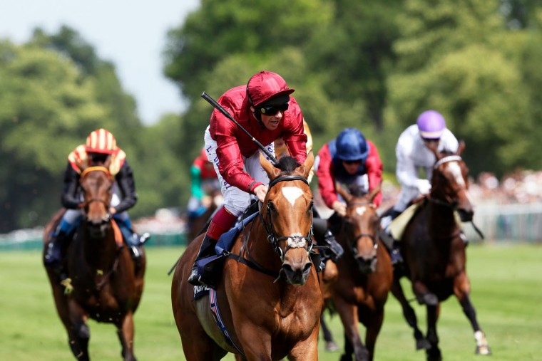 Frankie Dettori on Star of Seville, center, rides to win the Prix de Diane horse race, a 2100-metre flat horse race open to fillies, in Chantilly, north of Paris, France, Sunday, June 14, 2015. (AP Photo/Thibault Camus)