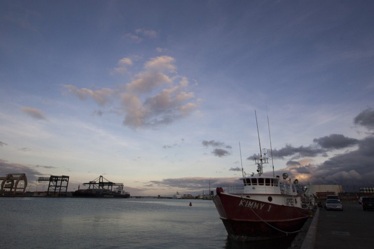 A fishing boat is docked outside United Fishing Agency in Honolulu, Thursday, June 18, 2015. Fresh fish arrive daily and are auctioned off to the highest bidders based on quality and market value. The auction is the biggest in the United States and one of the largest in the world. (AP Photo/Caleb Jones)