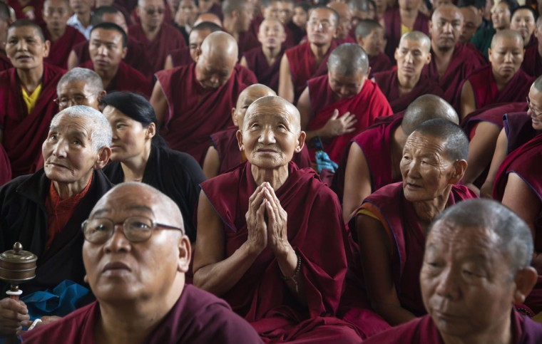 Exile Tibetan Buddhist nuns watch their spiritual leader the Dalai Lama on a television during an official prayer ceremony to celebrate his 80th birthday in Dharmsala, India, Sunday, June 21, 2015. The Dalai Lama was born on July 6 according to the Gregorian calendar but his birthday this year falls on June 21 according to the lunar calendar followed traditionally by Tibetans. (AP Photo/Ashwini Bhatia)