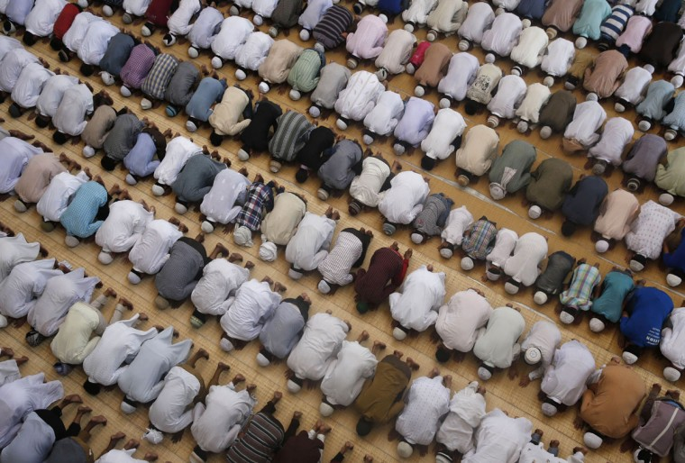 Indian Muslims offer prayers during the holy Islamic month of Ramadan at a mosque in Allhabad, India, Friday, June 19, 2015. Muslims throughout the world are marking the month of Ramadan, the holiest month in the Islamic calendar during which devotees fast from dawn till dusk. (AP Photo/Rajesh Kumar Singh)