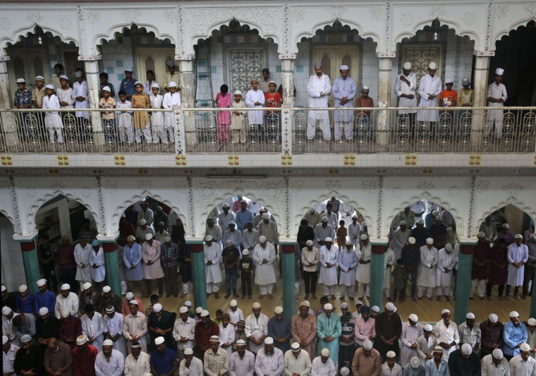 Indian Muslims offer prayers on the first Friday of the holy Islamic month of Ramadan at a mosque in Allhabad, India, Friday, June 19, 2015.Muslims throughout the world are marking the month of Ramadan, the holiest month on the Islamic calendar during which devotees fast from dawn till dusk. (AP Photo/ Rajesh Kumar Singh)