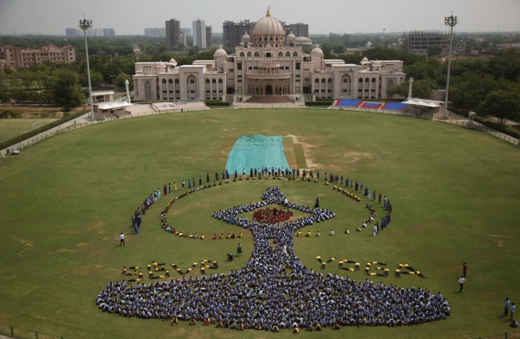 Indian students make a formation of the International Yoga Day symbol at a school in Ahmadabad, India, Friday, June 19, 2015. Sunday, June 21, marks the first International Yoga Day, which the government of Prime Minister Narendra Modi is marking with a massive outdoor New Delhi gathering.(AP Photo/Ajit Solanki)