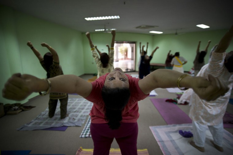 Indians perform yoga at the Morarji Desai National Institute of Yoga, in New Delhi, India. There are no reliable estimates of how many people regularly practice yoga in India, though the number is certainly in the millions. Sunday, June 21, 2015, marks the first International Yoga Day, which the government of Prime Minister Narendra Modi is marking with a massive outdoor New Delhi gathering. (AP Photo/Saurabh Das)
