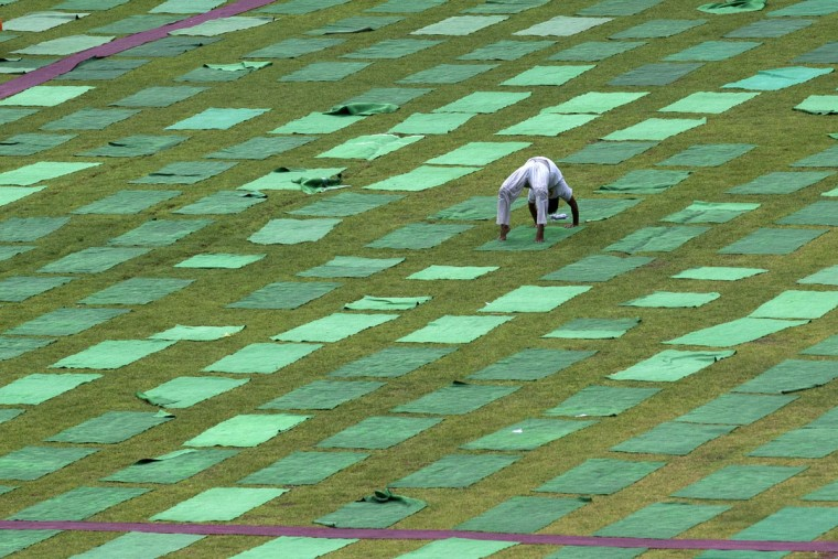 An Indian performs yoga in a stadium in New Delhi, India. Yoga has a long history India, reaching back for thousands of years. Sunday, June 21, 2015, marks the first International Yoga Day, which the government of Prime Minister Narendra Modi is marking with a massive outdoor New Delhi gathering. (AP Photo/Tsering Topgyal)
