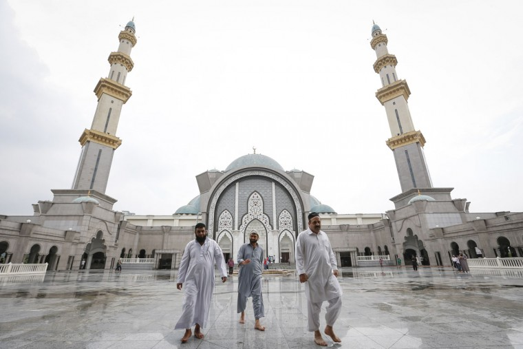 Muslims leave Wilayah Mosque after the Friday prayer during the holy Islamic month of Ramadan in Kuala Lumpur, Malaysia Friday, June 19, 2015. During Ramadan, Muslims refrain from eating, drinking, smoking and sex from dawn to dusk. (AP Photo/Vincent Thian)