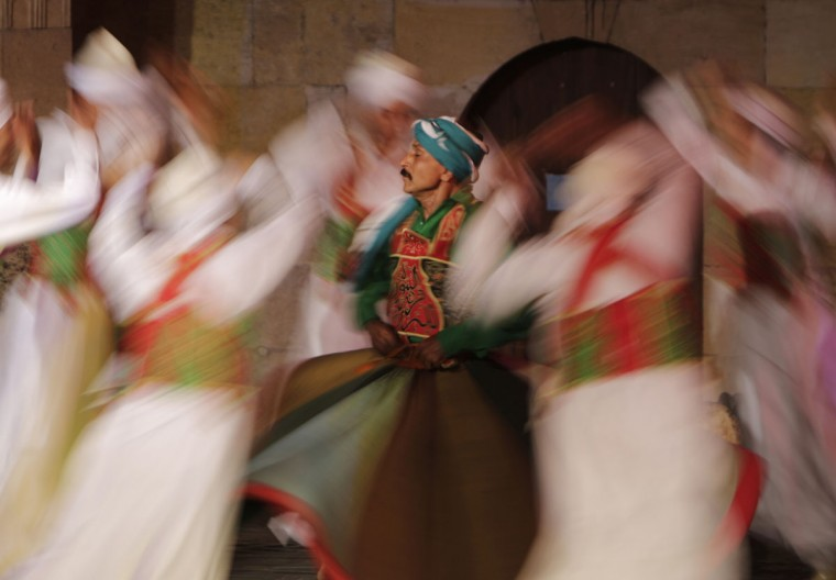 In this Saturday, May 30, 2015 photo, whirling dervishes members of the Al-Tannura Egyptian Heritage Dance Troupe Al-Tannoura Egyptian Heritage Dance Troupe spin during a performance at the 15th century Ghouri Palace, in Cairo, Egypt. Religious devotion is at the heart of almost everything. The spinning of the dervish dancers is partially meant to symbolize the way Muslim pilgrims performing the Hajj pilgrimage ritually circle the cube-shaped Kabaa in Mecca, Saudi Arabia. (AP Photo/Amr Nabil)
