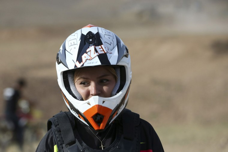 In this photo taken Sunday, May 31, 2015, Iranian motocross rider Behnaz Shafiei rests during her training session at a racetrack near the city of Hashtgerd, some 45 miles (73 kilometers) west of the capital Tehran, Iran. (AP Photo/Vahid Salemi)
