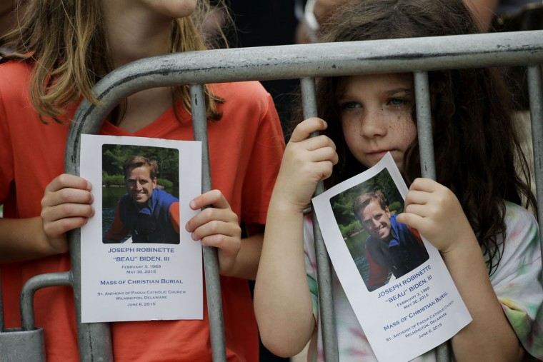 Children gather outside St. Anthony of Padua Roman Catholic Church in Wilmington, Del., Saturday, June 6, 2015, before funeral services for former Delaware Attorney General Beau Biden. Biden, the eldest son of the vice president, died of brain cancer May 30 at age 46. (AP Photo/Matt Rourke)