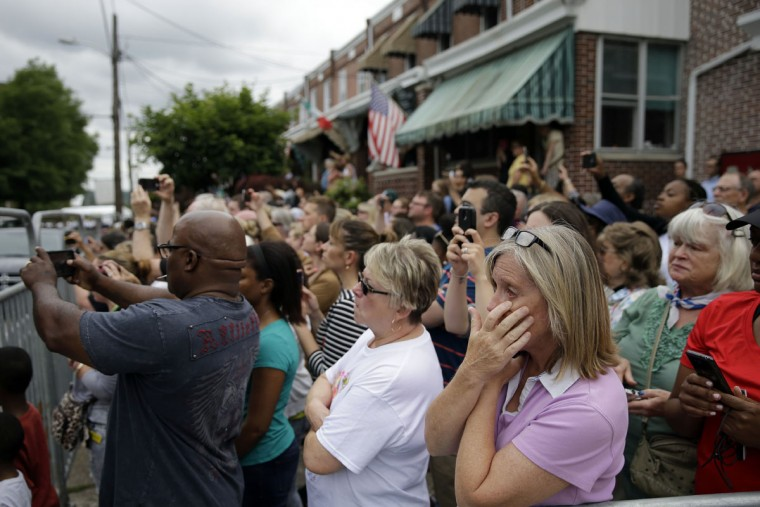 Mourners view the funeral procession for former Delaware Attorney General Beau Biden, Saturday, June 6, 2015, at St. Anthony of Padua Roman Catholic Church in Wilmington, Del. Biden, the eldest son of the vice president, died of brain cancer May 30 at age 46. (AP Photo/Matt Rourke)