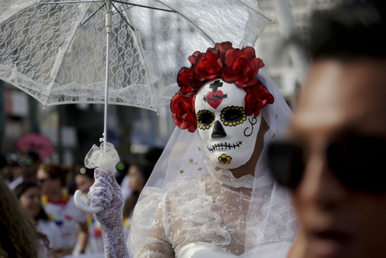 A man dressed as a calavera Catrina takes part in the gay pride parade in Panama City, Saturday, June 27, 2015. (AP Photo/Arnulfo Franco)