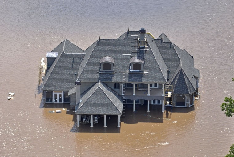 This photo released by the Bossier City Sheriff's Office shows a house during flooding from the Red River in Shreveport, La., Monday, June 8, 2015. The Red River leveled off at Shreveport on Tuesday. It reached 37.09 feet in the afternoon, meteorologist Davyon Hill said. (Bill Davis/Bossier City Sheriff's Office via AP)