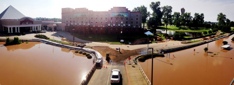 Boomtown Casino is dealing with problems from the flood Monday, June 8, 2015. The bottom floor of the parking garage is flooded, and access to the casino has gone down to a single lane as a wall is being built to stop flooding of the drive in Bossier City. (Henrietta Wildsmith/The Shreveport Times via AP)