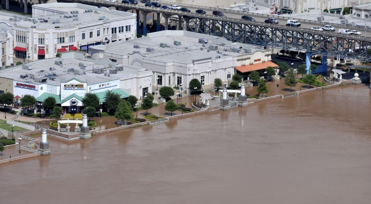 This photo released by the Bossier City Sheriff's Office shows flooding in the Louisiana Boardwalk, along the Red River, in Bossier City, La., Monday, June 8, 2015. The Red River leveled off at Shreveport on Tuesday. It reached 37.09 feet in the afternoon, meteorologist Davyon Hill said. (Bill Davis/Bossier City Sheriff's Office via AP)