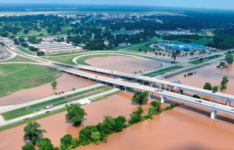 This Monday, June 8, 2015 photo provided by the Bossier City Sheriff's Office shows flooding from the Red River at the Shreveport-Barksdale Boulevard bridge, over the river, in Bossier City, La. The National Weather Service says the Red River is leveling off at Shreveport, with changes being measured in hundredths of a foot. Meteorologist Davyon Hill says it reached 37.09 feet Tuesday afternoon. (Bill Davis/Bossier City Sheriff's Office via AP)
