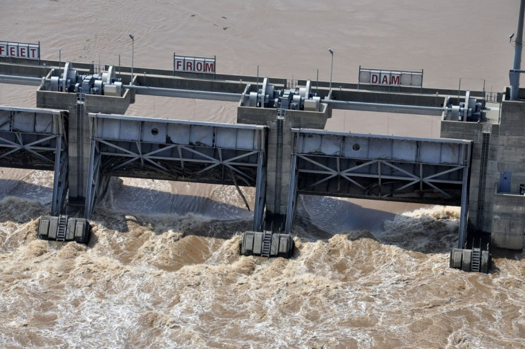 This photo released by the Bossier City Sheriff's Office shows high water flowing through Lock and Dam #5 during flooding of the Red River in South Bossier Parish, La., Monday, June 8, 2015. The Red River leveled off at Shreveport on Tuesday. It reached 37.09 feet in the afternoon, meteorologist Davyon Hill said. (Bill Davis/Bossier City Sheriff's Office via AP)