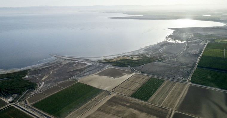 In this May 1, 2015, aerial photo, exposed lake bed of the Salton Sea dries out near Niland, Calif. San Diego and other Southern California water agencies will stop replenishing the lake in 2017, raising concerns that dust from the exposed lake bed will exacerbate asthma and other respiratory illness in a region whose air quality already fails federal standards. (AP Photo/Gregory Bull)