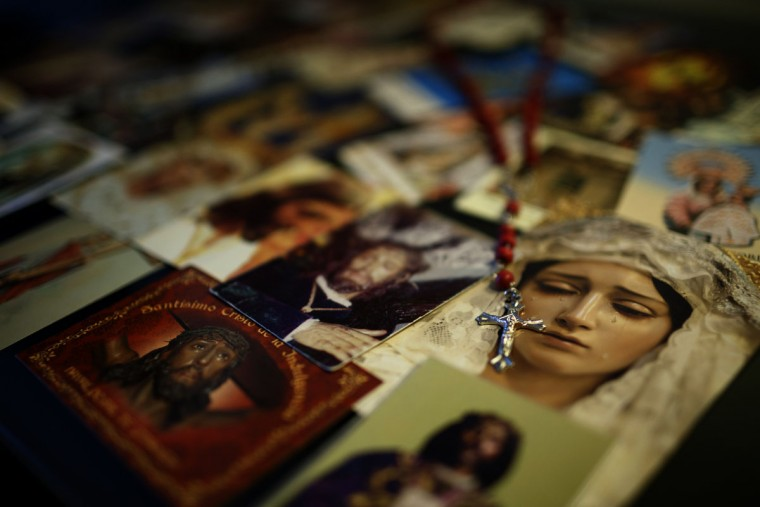 In this photo taken Saturday, May 30, 2015, pictures depicting religious images are placed on a table inside Spanish bullfighter Alvaro Lorenzo hotel room as he prepares for a bullfight with Alcurrucen ranch fighting bulls in Aranjuez, near Madrid, Spain. Bullfighters are usually dressed by their best men, and assistant named 'mozo de espadas', a ritual usually undertaken in silence and in a ceremonial manner. Bullfighting is an ancient tradition in Spain. (AP Photo/Daniel Ochoa de Olza)