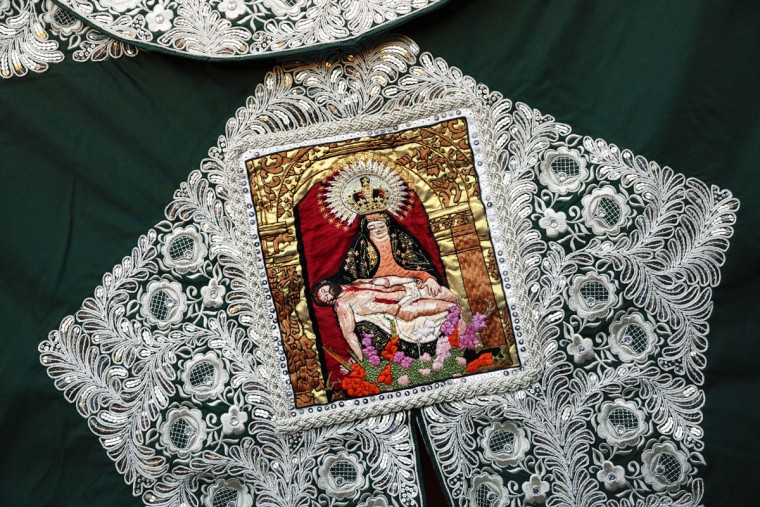 In this photo taken Saturday, May 30, 2015, an image depicting a religious scene embroidered in a capote, or bullfighters cape, is displayed during a bullfight in Aranjuez, near Madrid, Spain. Bullfighting is an ancient tradition in Spain. (AP Photo/Daniel Ochoa de Olza)