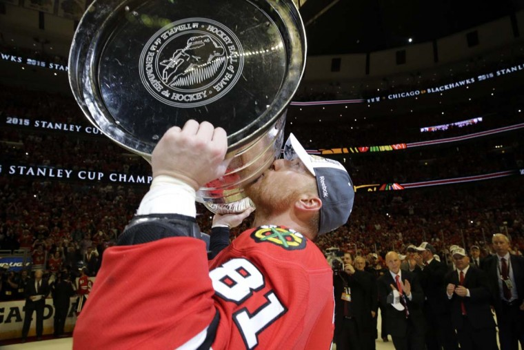 Chicago Blackhawksí Marian Hossa, of Slovakia, kisses the Stanley Cup Trophy after defeating the Tampa Bay Lightning in Game 6 of the NHL hockey Stanley Cup Final series on Monday, June 15, 2015, in Chicago. The Blackhawks defeated the Lightning 2-0 to win the series 4-2. (AP Photo/Nam Y. Huh)