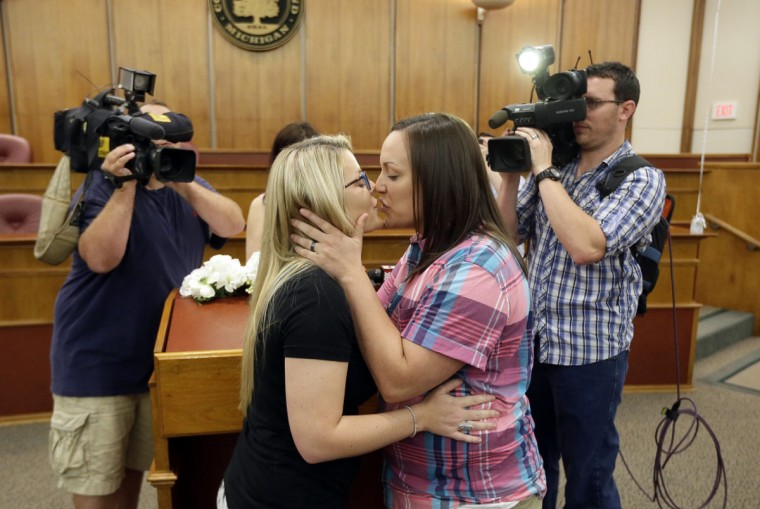 Breanne Brodak, left, and Cortney Tucker kiss after being married by Oakland County Clerk Lisa Brown, Friday, June 26, 2015, in Pontiac, Mich. The Supreme Court declared Friday that same-sex couples have a right to marry anywhere in the United States. (AP Photo/Carlos Osorio)