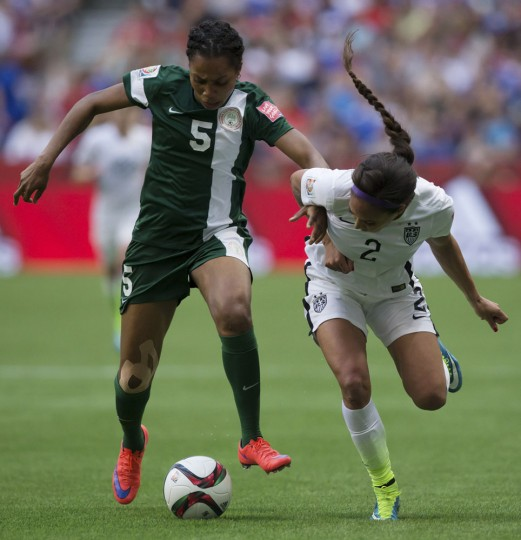 Nigeria's Onome Ebi, left, defends United States' Sydney Leroux during the second half of a FIFA Women's World Cup soccer game Tuesday, June 16, 2105, in Vancouver, British Columbia, Canada. (Darryl Dyck/The Canadian Press via AP)