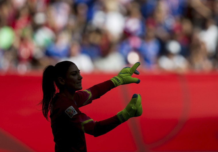 United States goal keeper Hope Solo is silhouetted as she directs her teammates during the first half of a FIFA Women's World Cup soccer game against Nigeria, Tuesday, June 16, 2105, in Vancouver, British Columbia, Canada. (Darryl Dyck/The Canadian Press via AP)