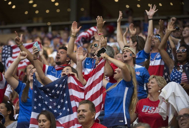 United States soccer fans cheer during the second half of a FIFA Women's World Cup soccer match against Nigeria, Tuesday, June 16, 2015 in Vancouver, New Brunswick, Canada. (Jonathan Hayward/The Canadian Press via AP)