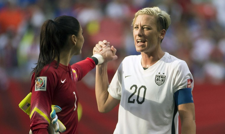 United States' Abby Wambach (20) celebrates her team's win with goal keeper Hope Solo following the second half of a FIFA Women's World Cup soccer match, Tuesday, June 16, 2015 in Vancouver, New Brunswick, Canada. (Jonathan Hayward/The Canadian Press via AP)