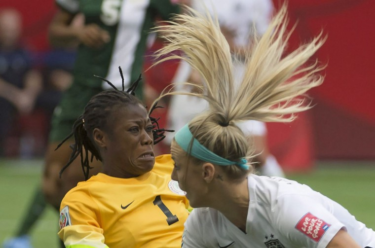 United States' Julie Johnston tries to get a shot past Nigeria goalkeeper Precious Dede during the first half of a FIFA Women's World Cup soccer match, Tuesday, June 16, 2015 in Vancouver, New Brunswick, Canada. (Jonathan Hayward/The Canadian Press via AP)